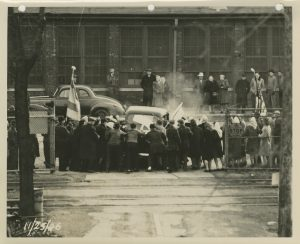Picketers try to prevent a car from entering the Allis-Chalmers factory, November 25, 1946.  United Auto Workers Local 248 waged a 13-month strike against the company from April 1946 to May 1947.  This picture was in company testimony before the U.S. House of Representatives Committee on Education and Labor, February 24, 1947, alleging the union was dominated by Communists.