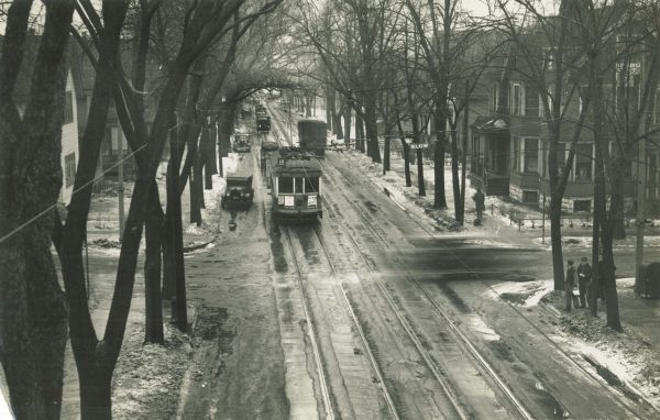 An electric streetcar heads north on Holton Street near E. Garfield Avenue in the early half of the twentieth century.