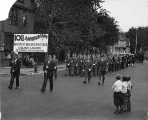 Members of the Polish Legion of American Veterans from Woodrow Wilson Post No. 11 lead a parade procession.