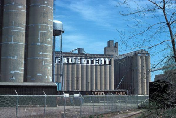 Taken in 1975, this photograph features the barley elevators once used by the Froedtert Malt Corporation.