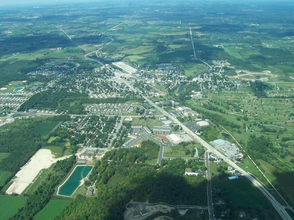 <table class=&quot;lightbox&quot;><tr><td colspan=2 class=&quot;lightbox-title&quot;>Aerial View of Kewaskum</td></tr><tr><td colspan=2 class=&quot;lightbox-caption&quot;>This aerial view of Kewaskum illustrates both the community's recent urban growth and its continued commitment to preserve rural landscapes. </td></tr><tr><td colspan=2 class=&quot;lightbox-spacer&quot;></td></tr><tr class=&quot;lightbox-detail&quot;><td class=&quot;cell-title&quot;>Source: </td><td class=&quot;cell-value&quot;>From Flickr. Photograph by username richmanwisco. CC BY-NC-SA 2.0.</td></tr><tr class=&quot;filler-row&quot;><td colspan=2>&nbsp;</td></tr></table>