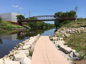 Three Bridges Park is located along the Menomonee River between 27th and 37th Streets. In an effort to reclaim land left vacant by deindustrialization in Milwaukee, the 24-acre park opened in 2013.