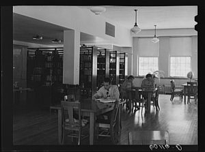 1939 photograph of patrons spending time at the first Greendale Public Library, which opened in 1938.