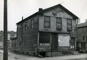 Building regulations, such as housing codes, categorized and quantified physical characteristics of structures in Milwaukee. This building, from the 1400 block of North 6th Street, was in such poor condition that it was razed soon after this photograph was taken in 1947.