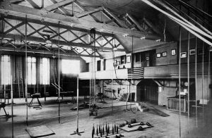 Indoor recreation in Milwaukee traces its roots to German gymnastics. This image, circa 1914, showcases the interior of a Milwaukee gymnastics hall.