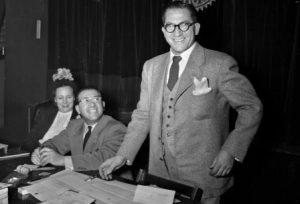 "William Calvano, national president of UNICO, stands next to Dorothy Matranga, Milwaukee chapter secretary, and Joseph Bruno, Milwaukee chapter president, in 1950. UNICO is the Italian word for ""unique."""