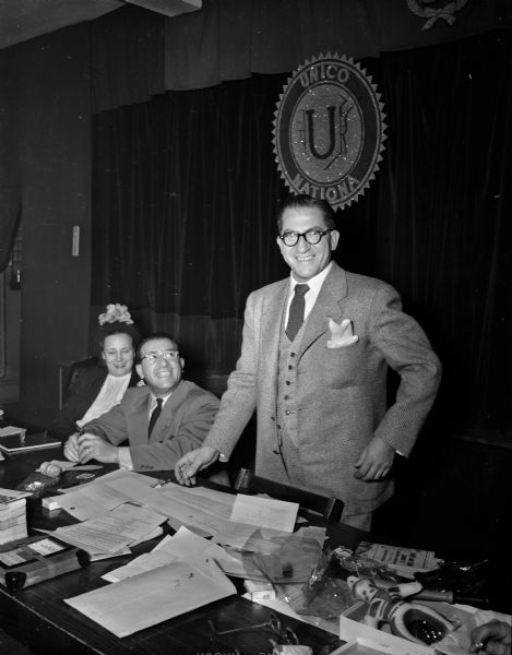"William Calvano, national president of UNICO, stands next to Dorothy Matranga, Milwaukee chapter secretary, and Joseph Bruno, Milwaukee chapter president, in 1950. UNICO is the Italian word for ""unique."""