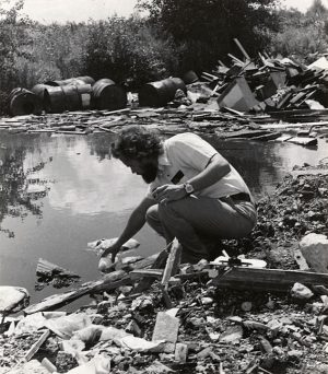 An employee from the Wisconsin Department of Natural Resources takes a water sample from an illegal dumping site in Menomonee Falls in 1978.