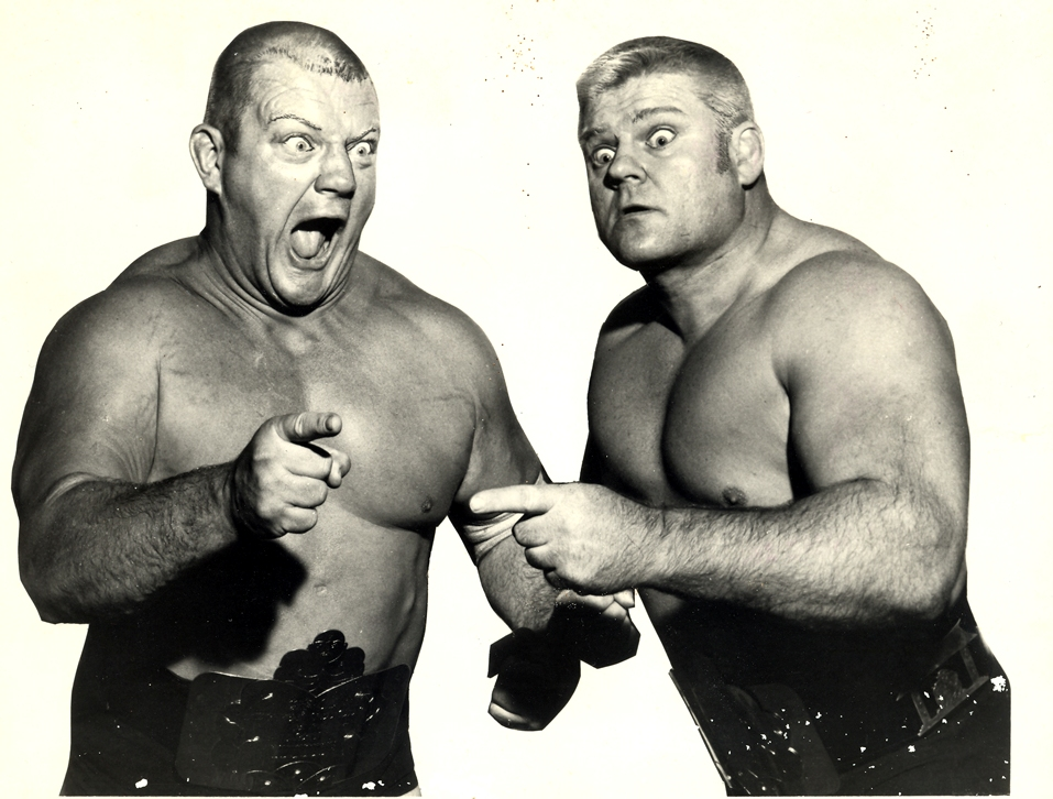 "A popular tag team in the 1950s and 1960s, Dick ""The Crusher"" Afflis is pictured with his wrestling partner, Milwaukee-born Reggie ""The Crusher"" Liswoski."