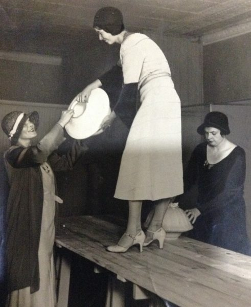 Three Junior League members clean their meeting space located on the corner of Mason Street and Milwaukee Avenue in 1930.