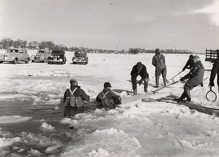 Muksego's lakes have long served as recreational attraction. In this 1941 photo, DNR employees dressed for the cold remove a net used for fish control from Bass Bay, a 100-acre embayment connected to Big Muskego Lake. Cars are parked on the thick ice on the left side of the image.