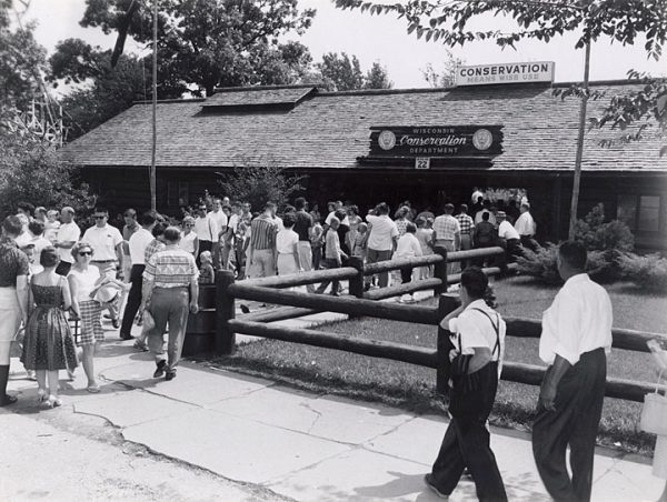 People prepare to enter the Wisconsin Conservation Department exhibit at the State Fair in 1960.