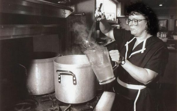 Barbara Franke, a waitress at Miss Katie's Diner in Milwaukee, pours boiled water into a pitcher for customers.