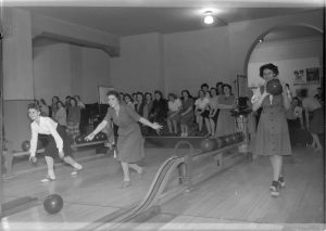 Bowling became an incredibly popular form of indoor recreation in the 1920s and continues to be so today. These women are bowling in the 1946 Milwaukee Journal's championship tournament.