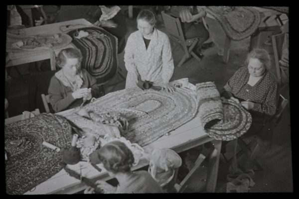 Four women work to make crochet rugs as part of the Milwaukee Handicraft Project. Begun in 1935, the project was designed to provide women with employment during the Great Depression.