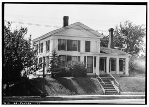This photograph showcases the home of Barnum Blake, a prominent settler and businessman in Port Washington. The house was first constructed in 1845.