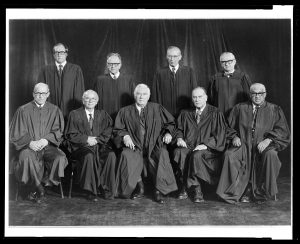 Justice William Rehnquist (back row, left) is pictured with the 1976 Supreme Court. He would be named Chief Justice in 1986.