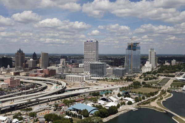 The newest Northwest Mutual Company building is under construction in this 2016 aerial photograph of Milwaukee's downtown. The Henry Maier Festival Park along Lake Michigan is in the foreground.