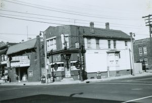 "The 700 Tap tavern was located on the corner of 7th and Walnut Streets, pictured here in 1961. The building with the ""Regal"" sign was used as church known by the name The Second House of Prayer."
