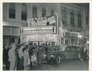 """A crowd of people gather outside the movie theater in Ripon, Wisconsin to welcome home Milwaukee native and Ripon College alumnus Spencer Tracy in celebration of his 1940 movie """"Edison the Man."""""""