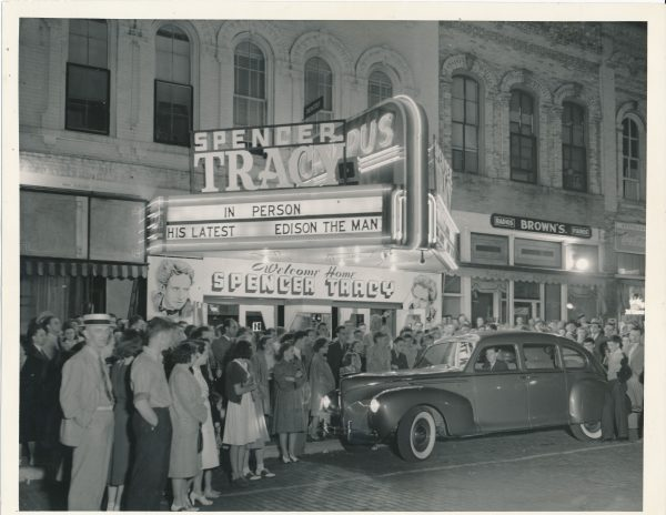 "A crowd of people gather outside the movie theater in Ripon, Wisconsin to welcome home Milwaukee native and Ripon College alumnus Spencer Tracy in celebration of his 1940 movie ""Edison the Man."""