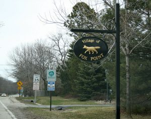 The current Fox Point village signage reflects early residents' observations that the area's land resembled the shape of a fox.