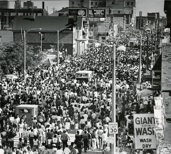 Crowds fill the street for a Juneteenth Day celebration in 1984. Juneteenth Day is observed on June 19th and commemorates the formal end of slavery in the United States.