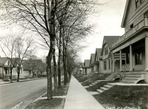 Single-family homes and duplexes are common in the Harambee neighborhood, like these that line 4th Street in 1923.