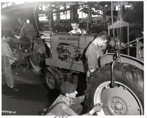 Allis-Chalmers was the driving economic force in West Allis. In this 1930s photo, employees build tractors along an assembly line.