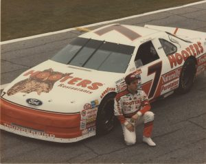 Alan Kulwicki of Greenfield, posing here with his race car, achieved great success as a short track driver before his untimely passing in 1993.