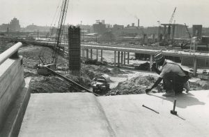 A man works on the original Marquette Interchange in 1966. During planning and initial construction, the project was known as the Central Interchange.