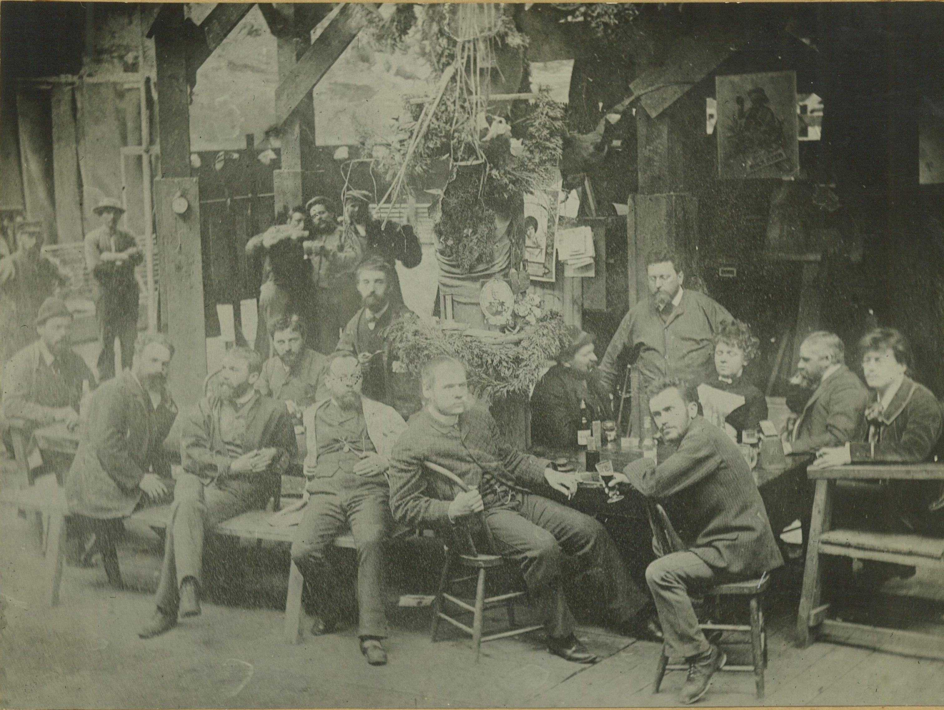 Milwaukee's panoramic painters sit around a table drinking beer in 1885. Richard Lorenz is seated furthest to the left behind the table.
