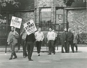 Members of  International Assoc. of Machinists & Aerospace Workers (IAMAW)-AFL-CIO picket with signs in 1968.