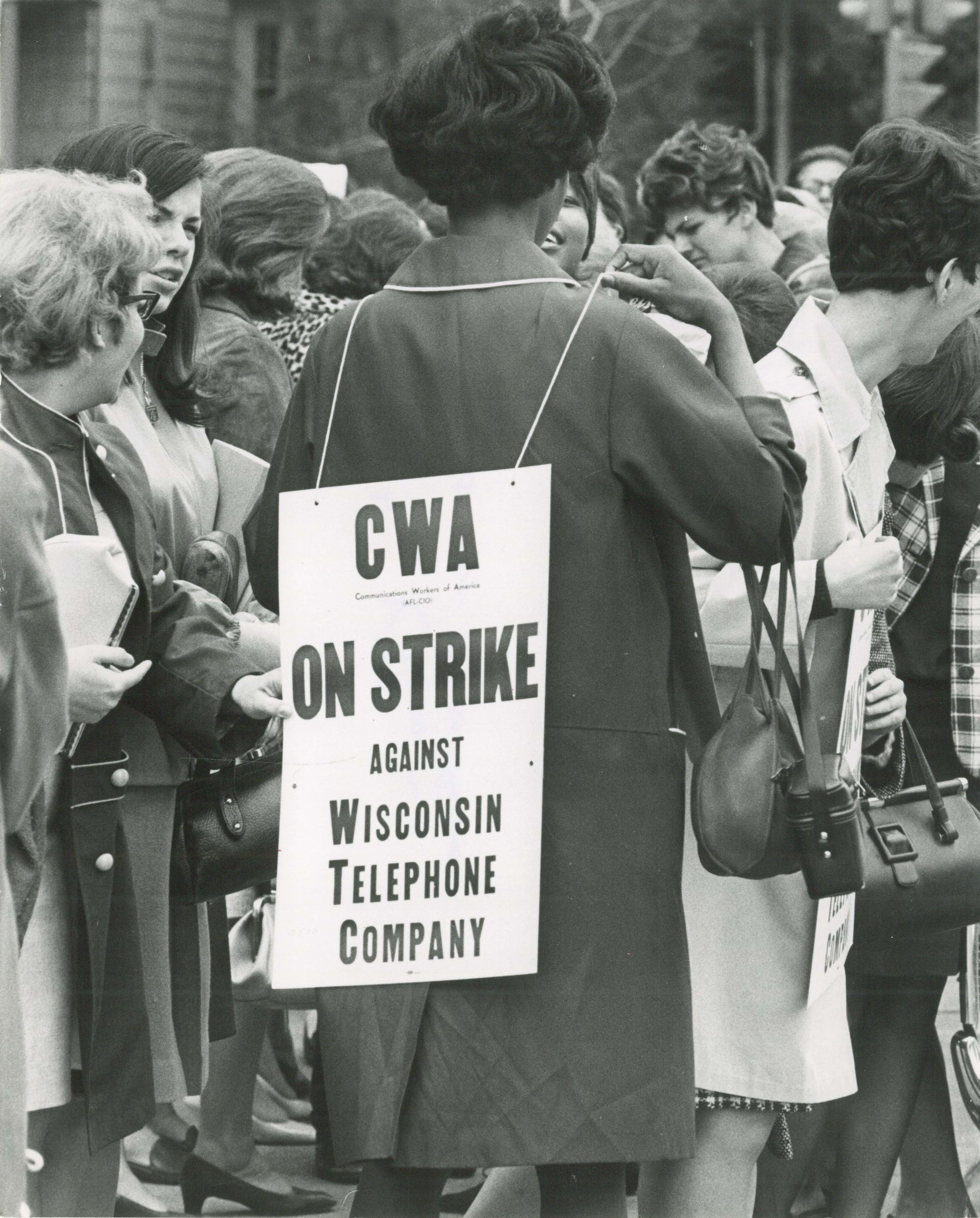 <table class=&quot;lightbox&quot;><tr><td colspan=2 class=&quot;lightbox-title&quot;>Picketing the Wisconsin Telephone Company</td></tr><tr><td colspan=2 class=&quot;lightbox-caption&quot;>Female members of the Communications Workers of America strike against the Wisconsin Telephone Company in 1968.</td></tr><tr><td colspan=2 class=&quot;lightbox-spacer&quot;></td></tr><tr class=&quot;lightbox-detail&quot;><td class=&quot;cell-title&quot;>Source: </td><td class=&quot;cell-value&quot;>From the Historic Photo Collection of the Milwaukee Public Library. Reprinted with permission.<br /><a href=&quot;http://content.mpl.org/cdm/singleitem/collection/HstoricPho/id/4020/rec/35&quot; target=&quot;_blank&quot;>Milwaukee Public Library</a></td></tr><tr class=&quot;filler-row&quot;><td colspan=2>&nbsp;</td></tr></table>