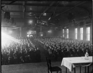 The South Side Armory Hall is filled with individuals attending a labor union meeting in the early 1930s.