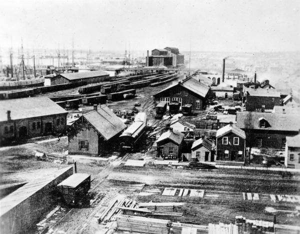 This elevated photograph provides a view of Milwaukee's first railroad depot around 1865. Passenger trains arrived here until the Reed Street depot was built in 1866.