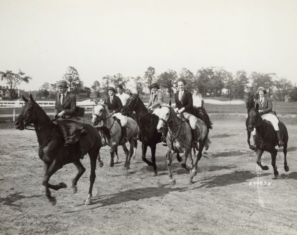 A group of young people ride horses at the Milwaukee Hunt Club in River Hills in 1930 with a golf course in the background. The country club was the center of community life for the village's wealthy residents.
