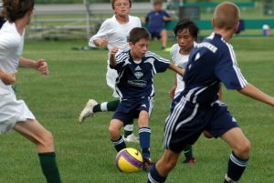 A young boy on the FC Milwaukee U14 soccer team attempts to keep the ball from his opponent in 2008.