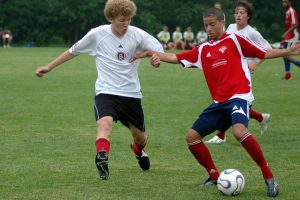 Private clubs such as FC Milwaukee, now known as FC Wisconsin, offer area youth of all ages to develop their soccer skills in matches held nationwide. Here, an FC Milwaukee player (right) faces his opponent from Springfield SC.