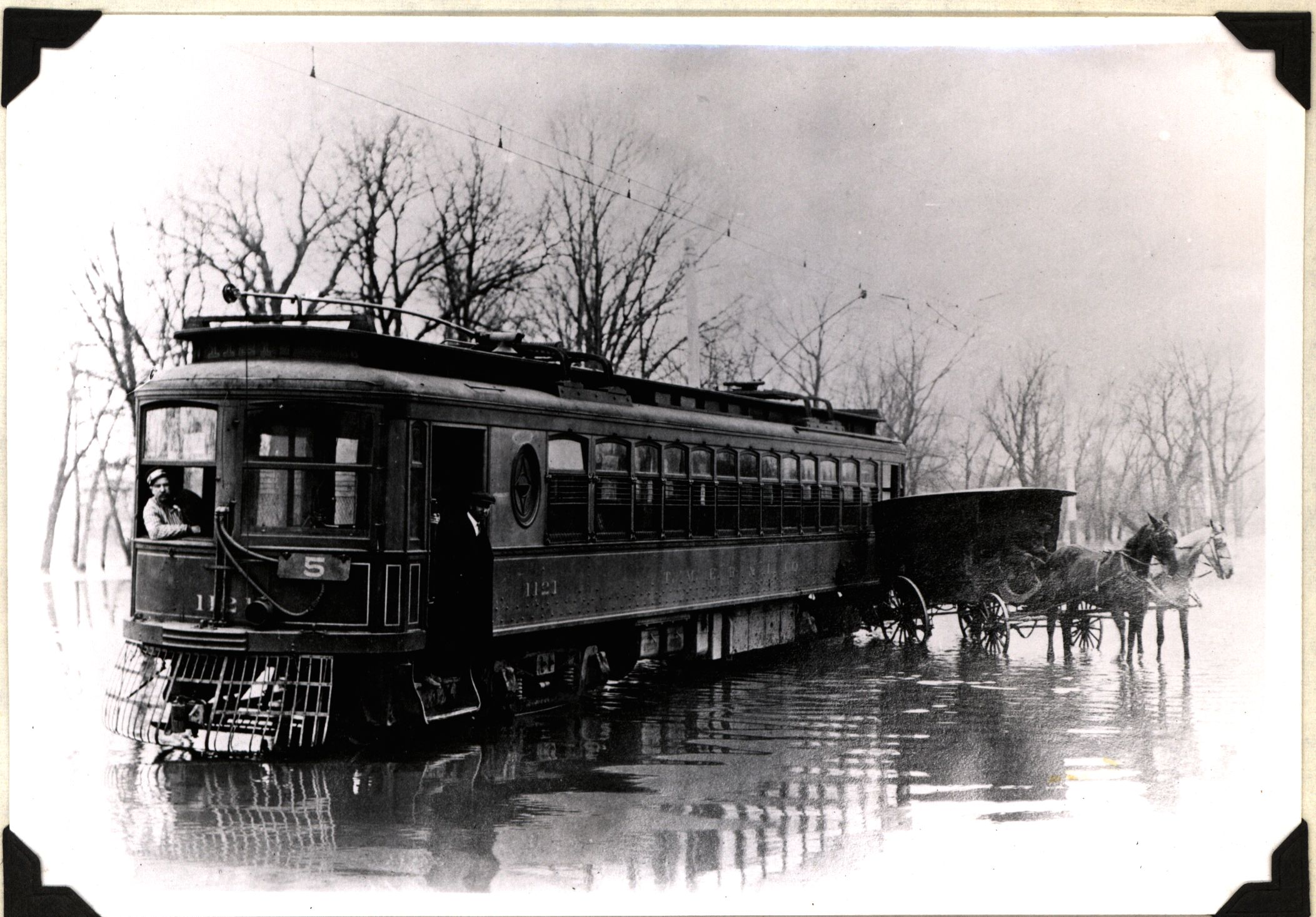 <table class=&quot;lightbox&quot;><tr><td colspan=2 class=&quot;lightbox-title&quot;>TMER&amp;L Car and Horse-Drawn Buggy</td></tr><tr><td colspan=2 class=&quot;lightbox-caption&quot;>A conductor leans from the window of this interurban car as it sits on a flooded Milwaukee street in this 1906 photograph.</td></tr><tr><td colspan=2 class=&quot;lightbox-spacer&quot;></td></tr><tr class=&quot;lightbox-detail&quot;><td class=&quot;cell-title&quot;>Source: </td><td class=&quot;cell-value&quot;>From the Robert W. Eichelberg Papers. Archives, University of Wisconsin-Milwaukee Libraries.<br /><a href=&quot;http://digicoll.library.wisc.edu/cgi/f/findaid/findaid-idx?c=wiarchives;view=reslist;subview=standard;didno=uw-mil-uwmmss0228;focusrgn=contentslist;cc=wiarchives;byte=47554507&quot; target=&quot;_blank&quot;>University of Wisconsin-Milwaukee Libraries</a></td></tr><tr class=&quot;filler-row&quot;><td colspan=2>&nbsp;</td></tr></table>