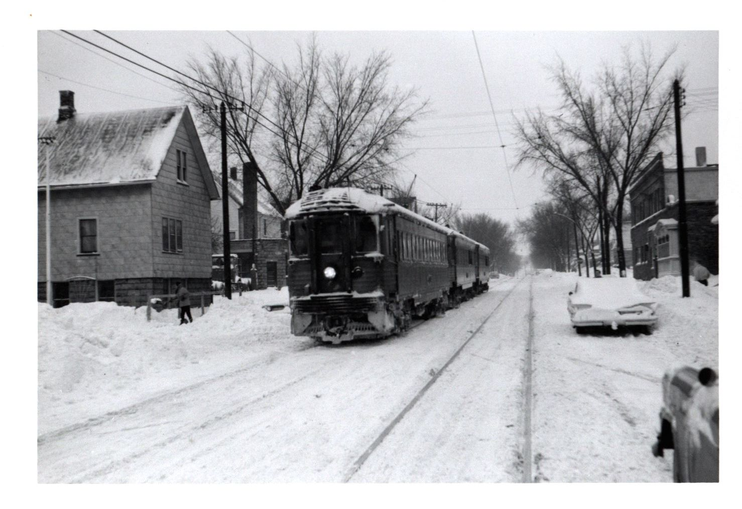 <table class=&quot;lightbox&quot;><tr><td colspan=2 class=&quot;lightbox-title&quot;>Milwaukee Interurban Line</td></tr><tr><td colspan=2 class=&quot;lightbox-caption&quot;>An interurban streetcar traverses a snowy Milwaukee neighborhood in this twentieth century photograph.</td></tr><tr><td colspan=2 class=&quot;lightbox-spacer&quot;></td></tr><tr class=&quot;lightbox-detail&quot;><td class=&quot;cell-title&quot;>Source: </td><td class=&quot;cell-value&quot;>From the Robert W. Eichelberg Papers. Archives, University of Wisconsin-Milwaukee Libraries.<br /><a href=&quot;http://digicoll.library.wisc.edu/cgi/f/findaid/findaid-idx?c=wiarchives;view=reslist;subview=standard;didno=uw-mil-uwmmss0228&quot; target=&quot;_blank&quot;>University of Wisconsin-Milwaukee Libraries</a></td></tr><tr class=&quot;filler-row&quot;><td colspan=2>&nbsp;</td></tr></table>