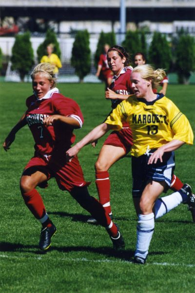 Kate Gordon of Marquette University's women's soccer team tries to outrun her opponent from the University of Wisconsin in 1999.