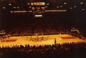 This photograph of a basketball game between Marquette University and the UW Badgers in 1978 highlights Robert Indiana's famed floor design.
