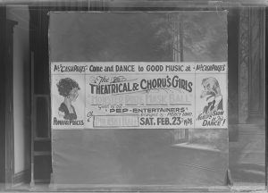 This 1924 poster advertises for dancing and prizes at a mask ball held at Pulaski Hall.