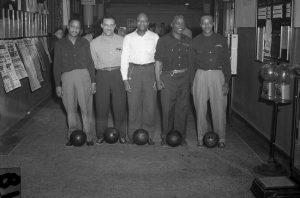 "African American workers commemorated their success in the Wisconsin CIO state bowling tournament in 1947.  Calling their team the ""Bronzeville Bombers,"" they worked in different factories in Milwaukee represented by CIO unions."