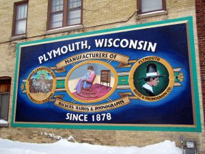 This painting on a building in Plymouth recalls some of the city's early manufacturing industries.