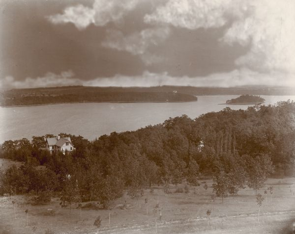This 1895 photograph looks down over Pine Lake, the centerpiece of the village of Chenequa, and George Brumder's summer home. Brumder was a German-language book and newspaper publisher from Milwaukee known across the United States.