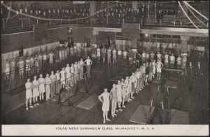 This early twentieth century postcard features young men gathered for a gymnasium class at the Milwaukee YMCA.