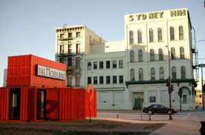The Sydney Hih building stands in the background of this 2008 photograph, four years before it was razed. In contrast, the temporary office of the Moderne luxury condos and apartments sits in the foreground.