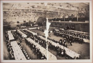 In this 1907 photograph, a large group of men are gathered in Milwaukee for a YMCA banquet.